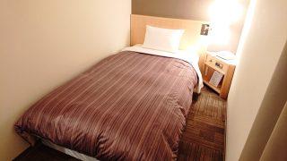 シングルルームのベッド|ホテルルートイン 札幌駅前北口